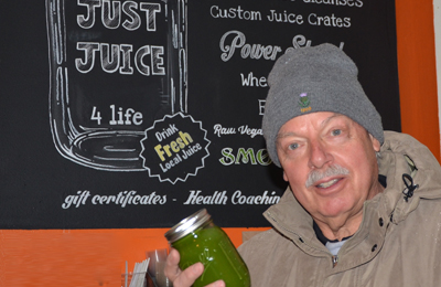 COLD PRESSED JUICE SMOOTHIES ROCHESTER NY_ man with green juice